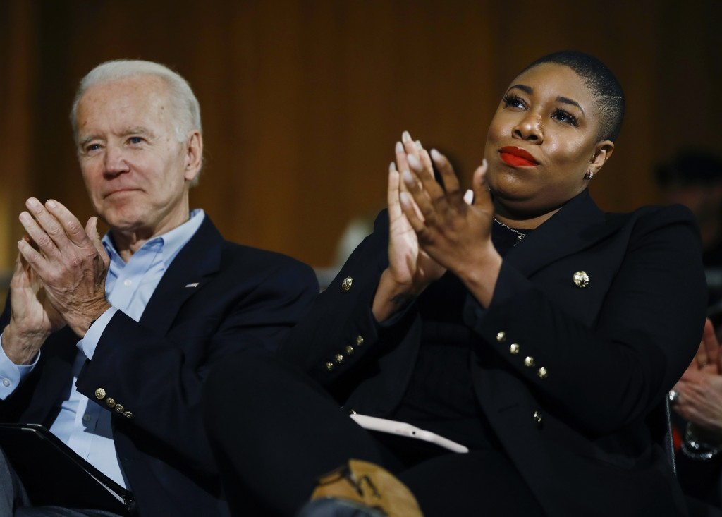 FILE - In this Jan. 27, 2020, file photo, Democratic presidential candidate, former Vice President Joe Biden and senior adviser Symone Sanders partici...