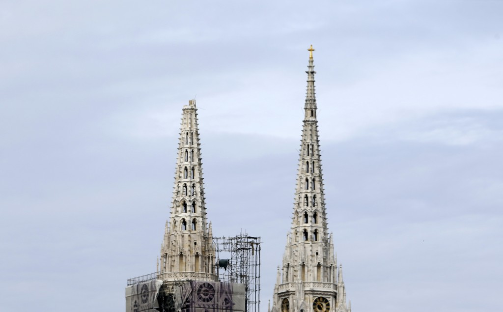 One of the damaged spires, left, of Zagreb's iconic cathedral is seen after an earthquake in Zagreb, Croatia, Sunday, March 22, 2020. The cathedral wa...