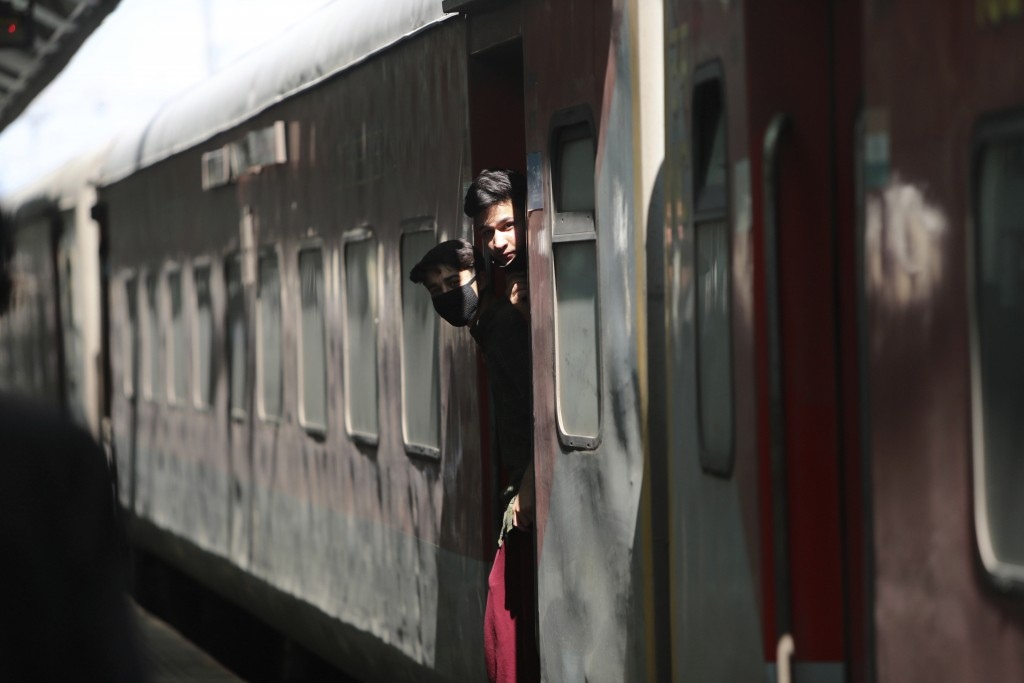 Indian students returning from Uttar Pradesh amid Coronavirus concerns arrive at a railway station in Jammu, India, Sunday, March 22, 2020. India is o...