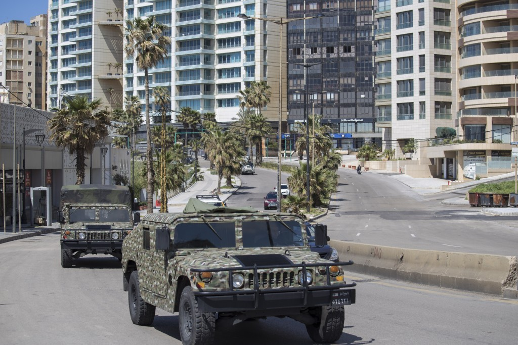 Lebanese army vehicles patrol the streets urging people to stay home unless they have to leave for an emergency in an effort to prevent the spread of ...