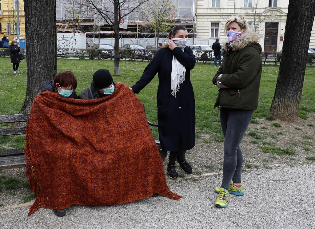 People rest in park after an earthquake in Zagreb, Croatia, Sunday, March 22, 2020. A strong earthquake shook Croatia and its capital on Sunday, causi...