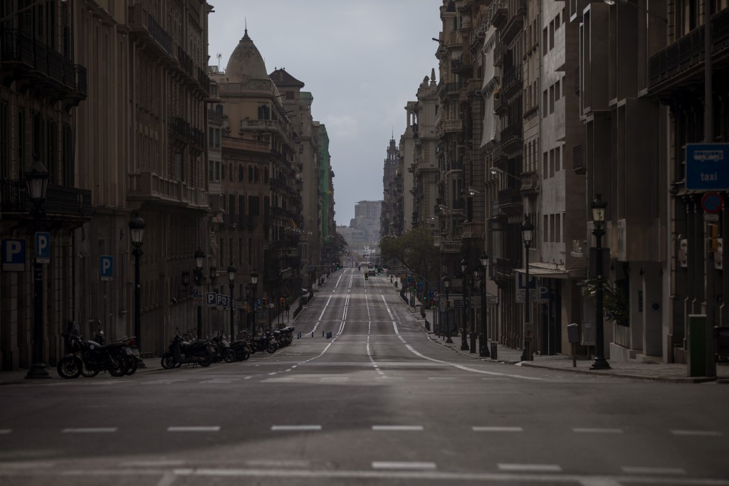 A view of Via Laietana street as authorities control public movements in Barcelona, Spain, Sunday, March 22, 2020. Spanish health authorities say inte...