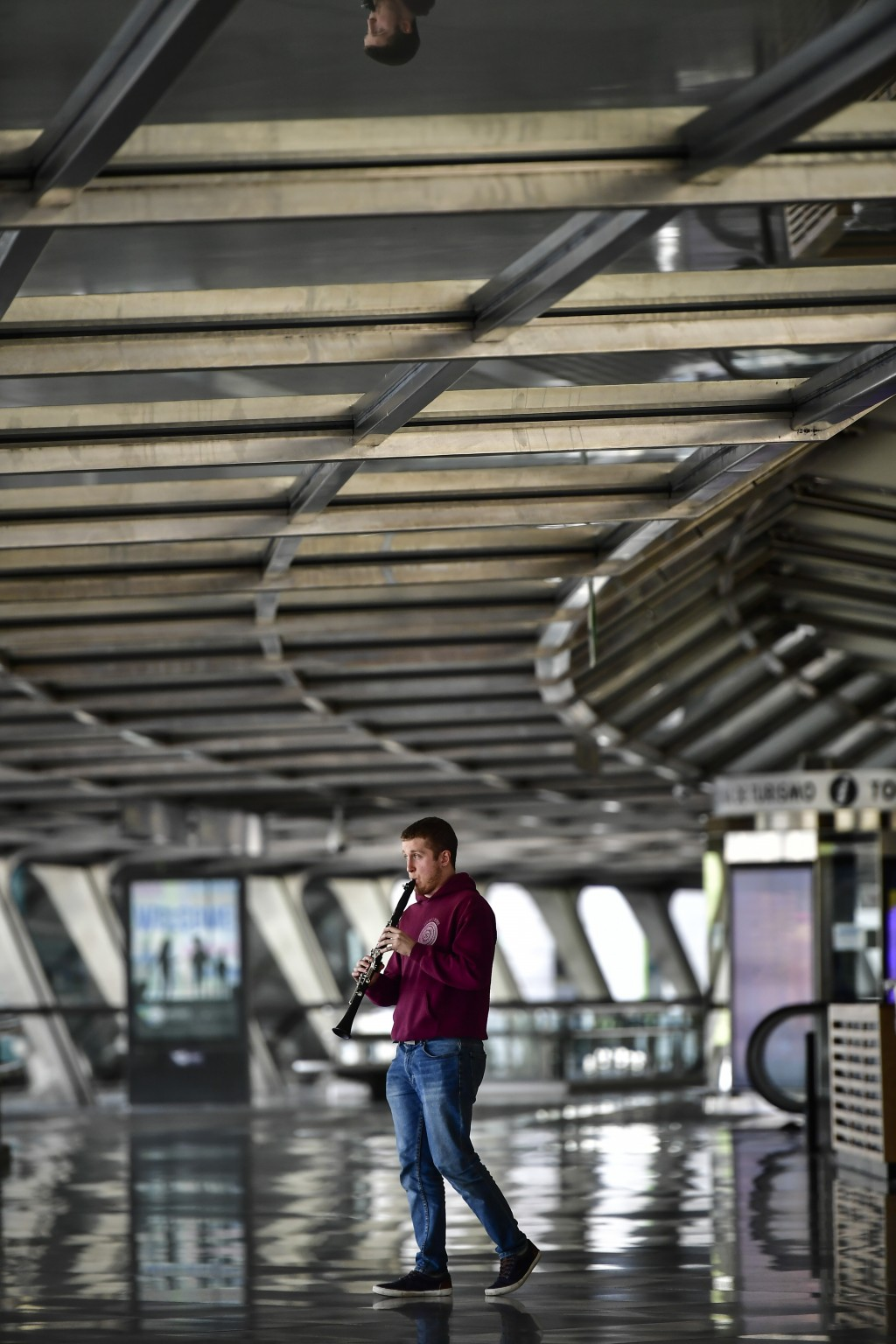 Benat Erro Diez, a young student musician plays his clarinet in the empty Loiu airport, near to Bilbao, northern Spain, Monday, March 23, 2020. For so...
