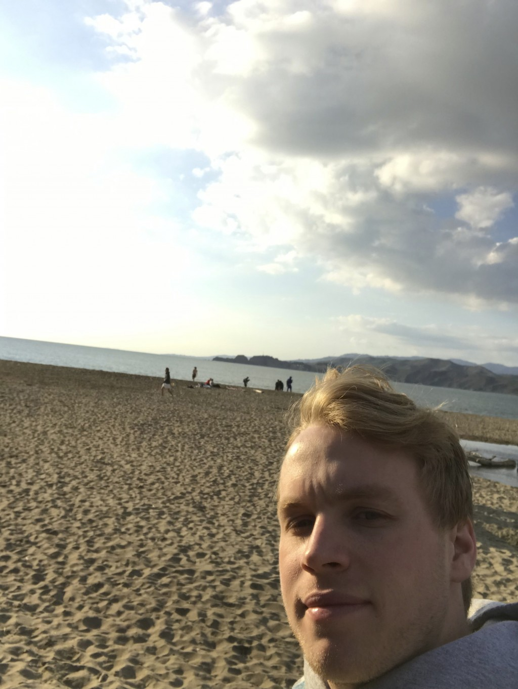 In this photo provided by Lance Sell, Sell takes a selfie on a San Francisco beach while walking, Friday, March 20, 2020. Sell, 19, is a freshman at L...