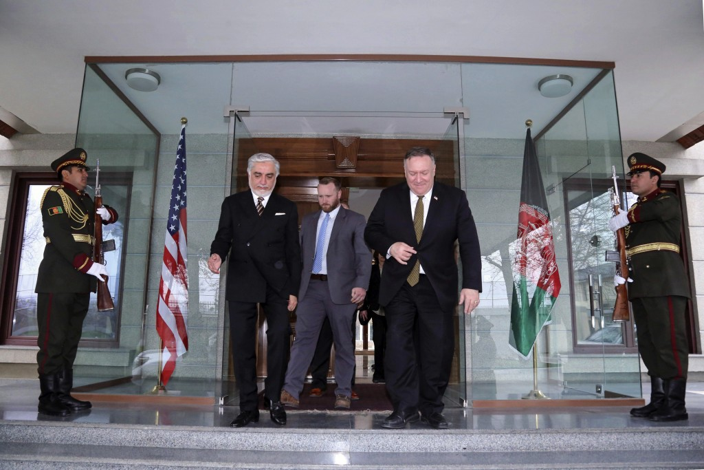 U.S. Secretary of State Mike Pompeo, center right, and Abdullah Abdullah the main political rival of President Ashraf Ghani, center left, walk at the ...