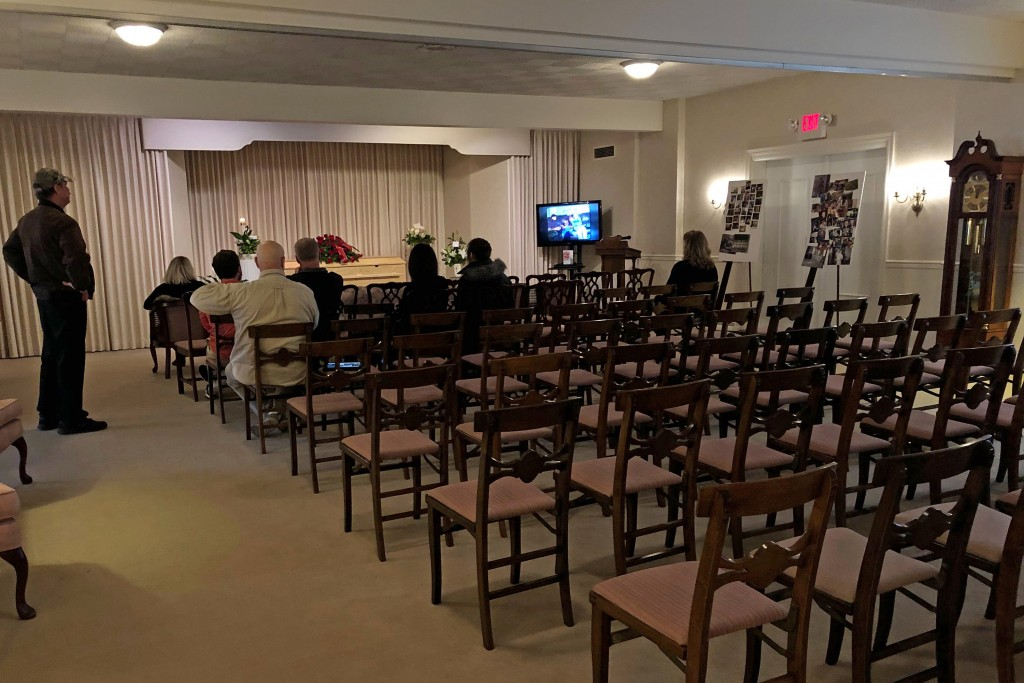 This March 18, 2020, photo shows a funeral that was affected by new rules put in place due to the coronavirus outbreak in Milwaukee. Wisconsin Gov. To...