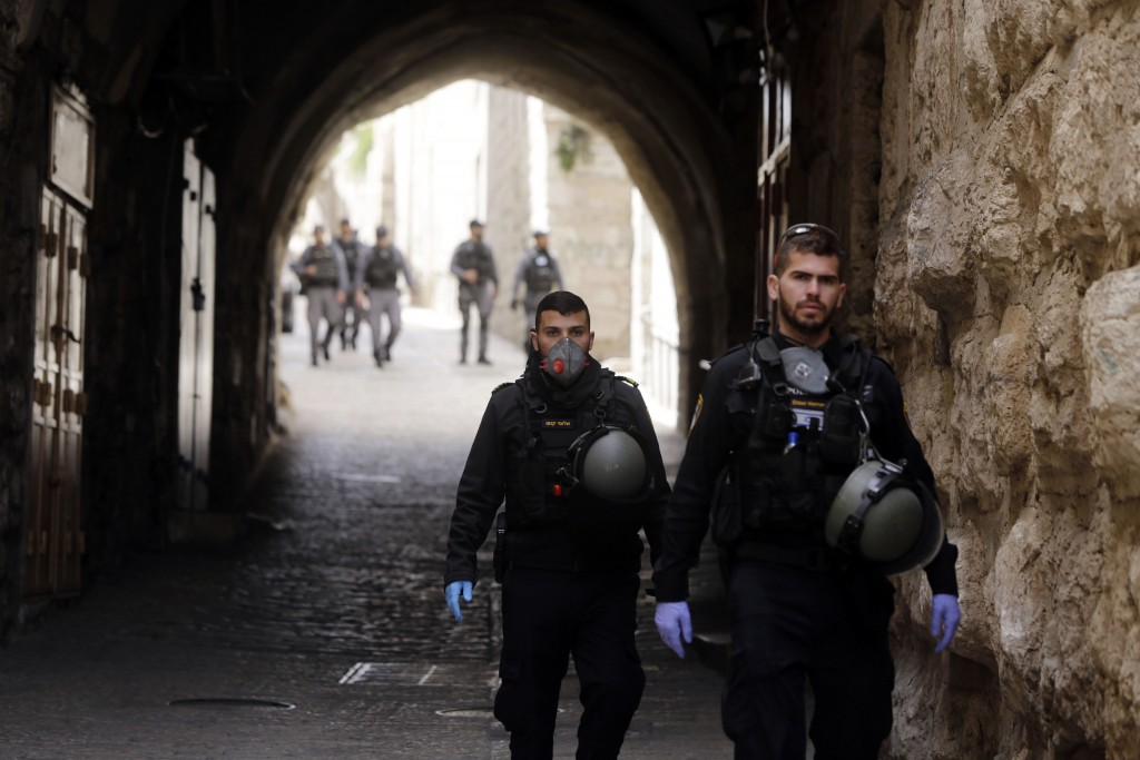 Israeli police patrols deserted street in Jerusalem's Old City, in Jerusalem, Monday, March 23, 2020. In Israel daily life has largely shut down with ...
