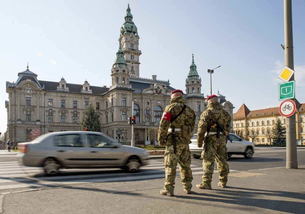 Military staff patrol in the downtown of Gyor, Hungary, Monday, March 23, 2020. The patrol is deployed to keep up public safety and order during the t...