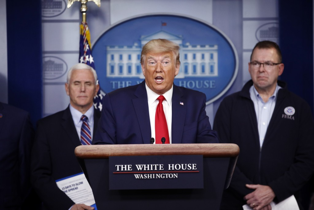 President Donald Trump speaks as Vice President Mike Pence, left, and FEMA Administrator Peter Gaynor look on, during a coronavirus task force briefin...