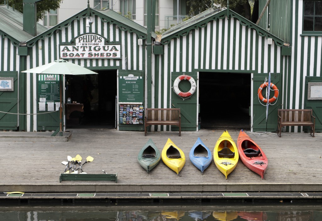 Empty kayaks sit on the banks of the Avon River in central Christchurch, New Zealand, Monday, March 23, 2020. New Zealand Prime Minister Jacinda Arder...