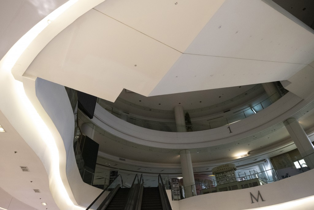 A shopping mall is empty in Bangkok, Thailand, Monday, March 23, 2020. The governor of the Thai capital Bangkok has ordered the city's popular shoppin...