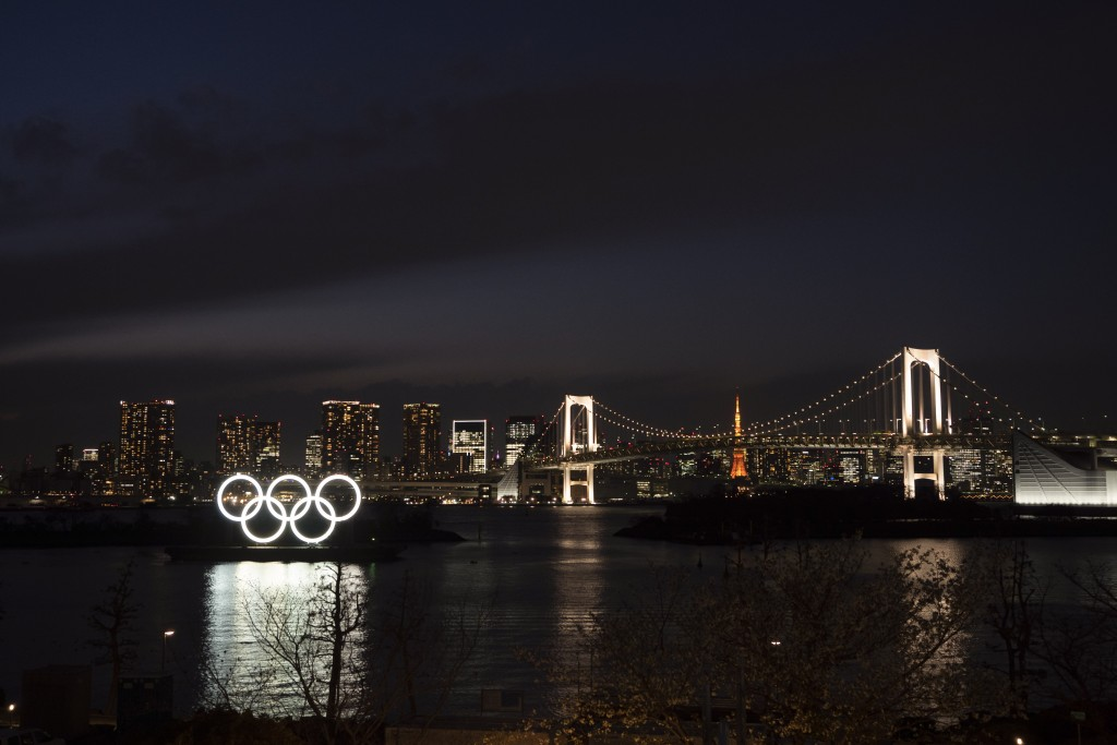 The Olympic rings float in the water near the Rainbow Bridge in the Odaiba section of Tokyo, Monday, March 23, 2020. The Tokyo Olympics are going to h...