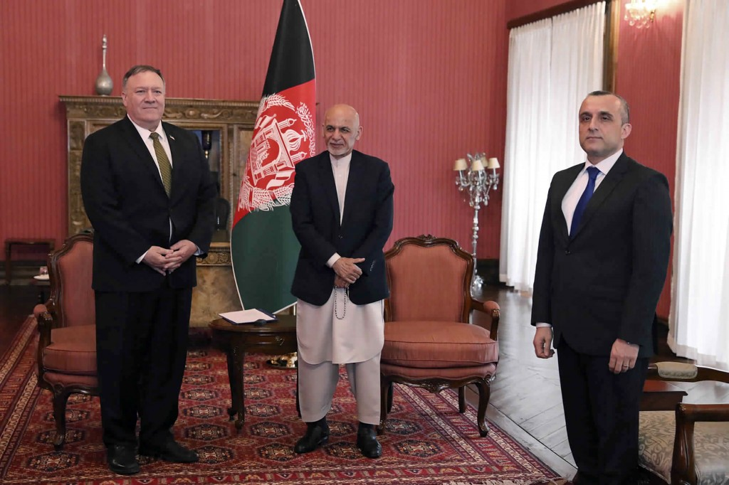 U.S. Secretary of State Mike Pompeo, left, stands with Afghan President Ashraf Ghani, center, and first Vice President Amrullah Saleh, at the Presiden...
