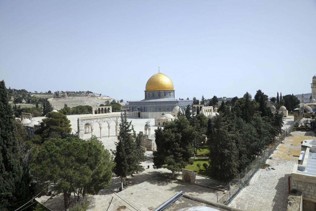 Dome of the Rock is seen at a deserted al-Aqsa mosque compound as all prayers are suspended to prevent the spread of coronavirus in Jerusalem, Monday,...