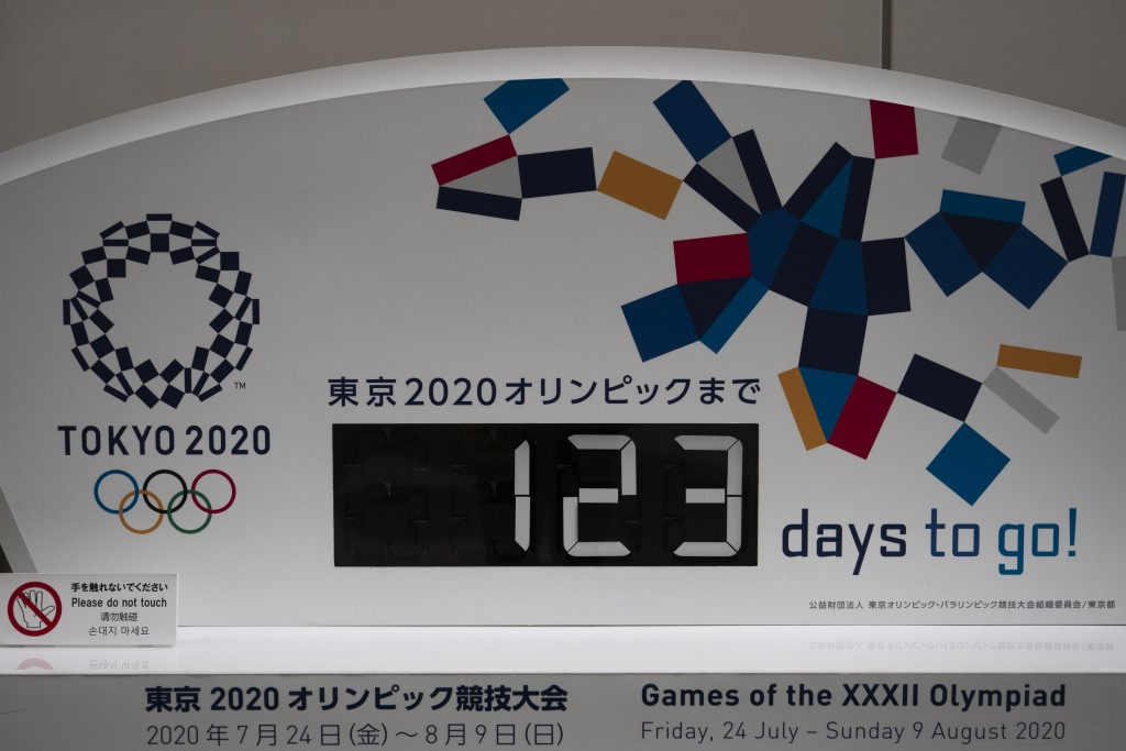 A countdown clock for the Tokyo 2020 Olympics is photographed in Tokyo, Monday, March 23, 2020. The IOC will take up to four weeks to consider postpon...