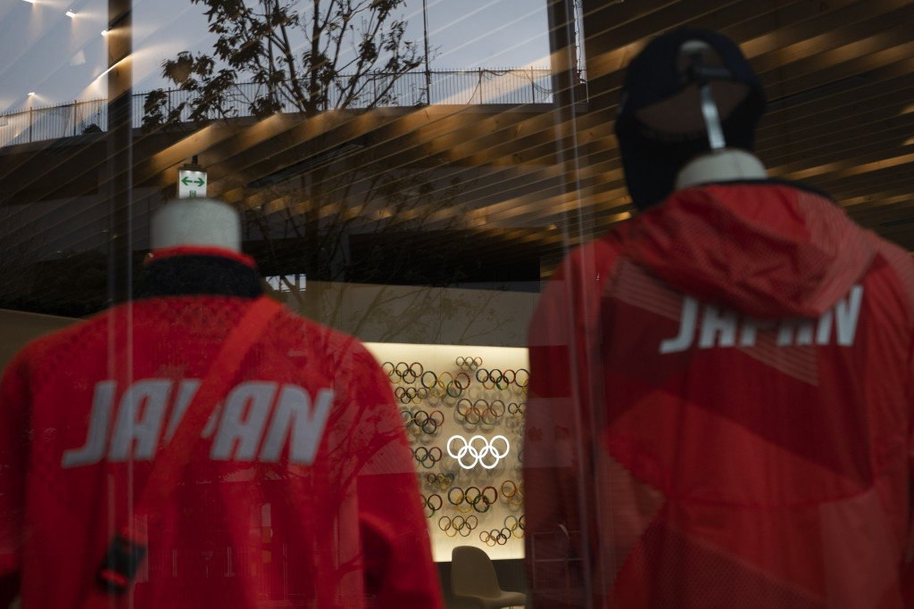The Olympics rings made with various materials and Japan national team's uniforms are on display at Tokyo Olympic Museum, in Tokyo, Monday, March 23, ...