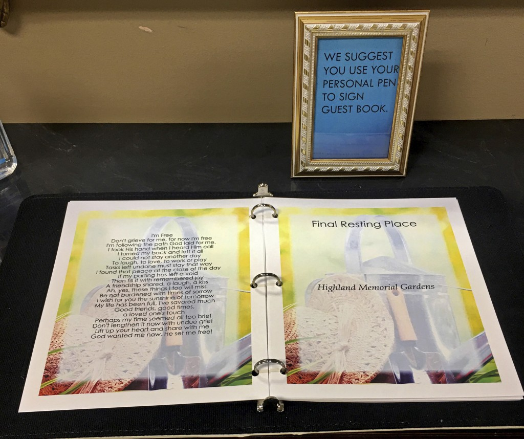 This March 19, 2020, photo provided by Bob Arrington of Arrington Funeral Directors shows a condolence book and procedures to avoid possible touching ...