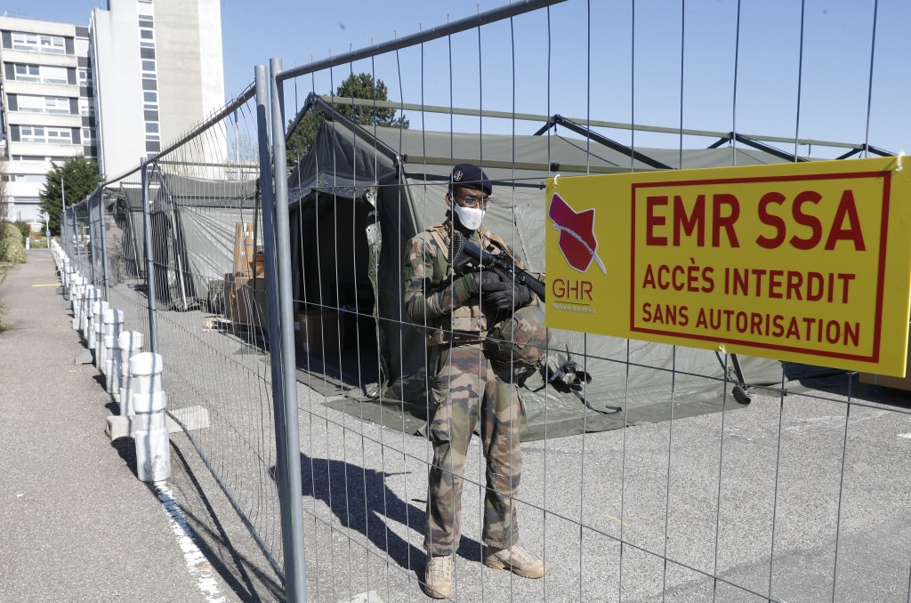 A soldier guards the Mulhouse military makeshift hospital build in Mulhouse, eastern France, Monday March 23, 2020. The Grand Est region is now the ep...