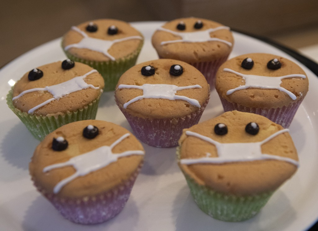 Timed to the current outbreak of the worldwide coronavirus, Covid-Free Cupcakes with icing masks are on display in the Cheesecake House and Restaurant...
