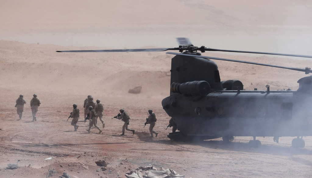 Emirati troops disembark an Emirati Boeing CH-47 Chinook during a military exercise at an Emirati military base home to a Military Operations in Urban...