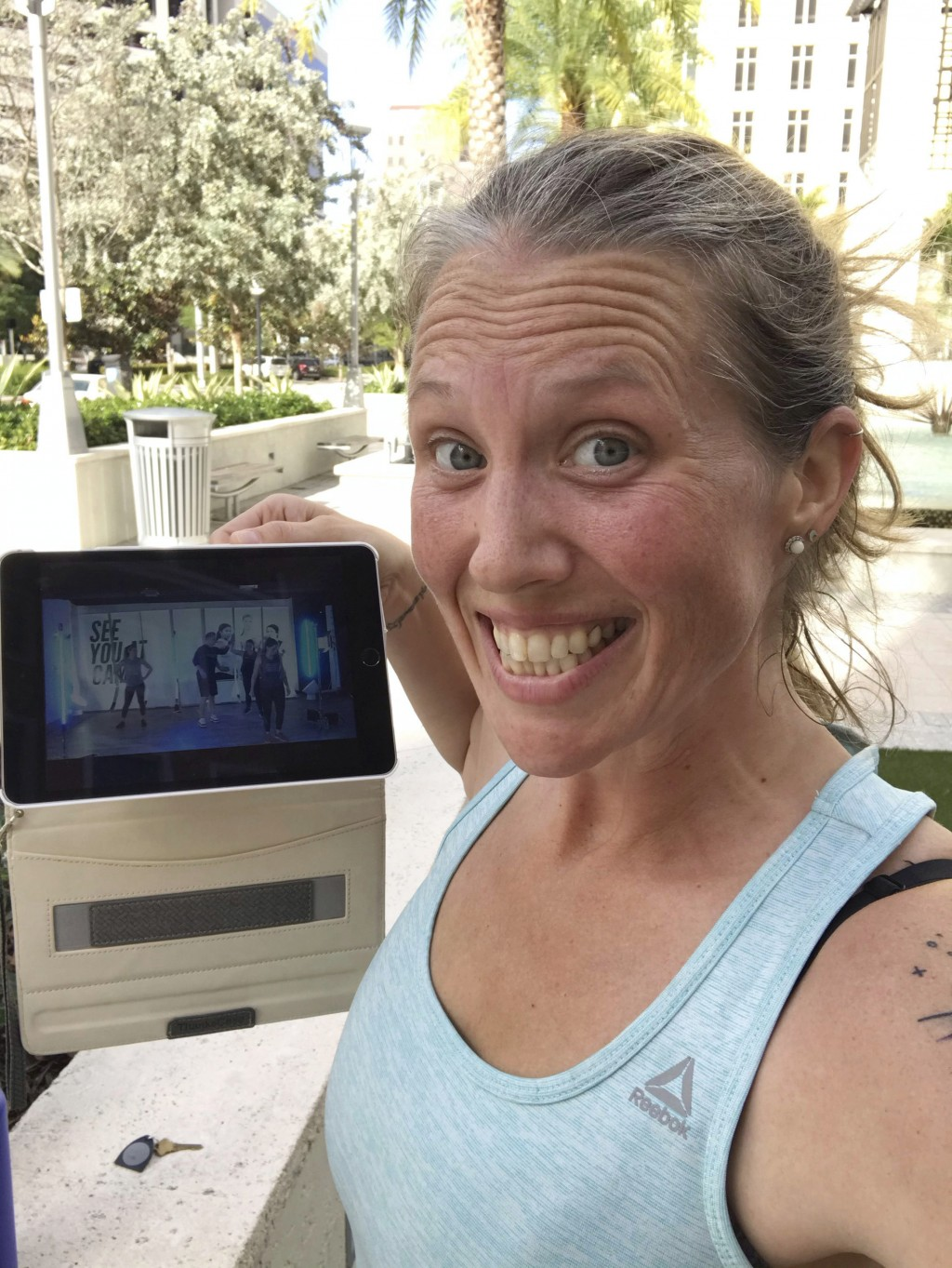 In this selfie provided by Beth Berglin, she shows a screen where she joins a Burn Boot Camp live stream workout from her home Thursday, March 19, 202...