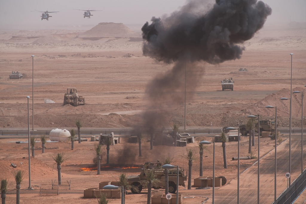 Emirati forces advance by land and air during an exercise at an Emirati military base home to a Military Operations in Urban Terrain facility in al-Ha...