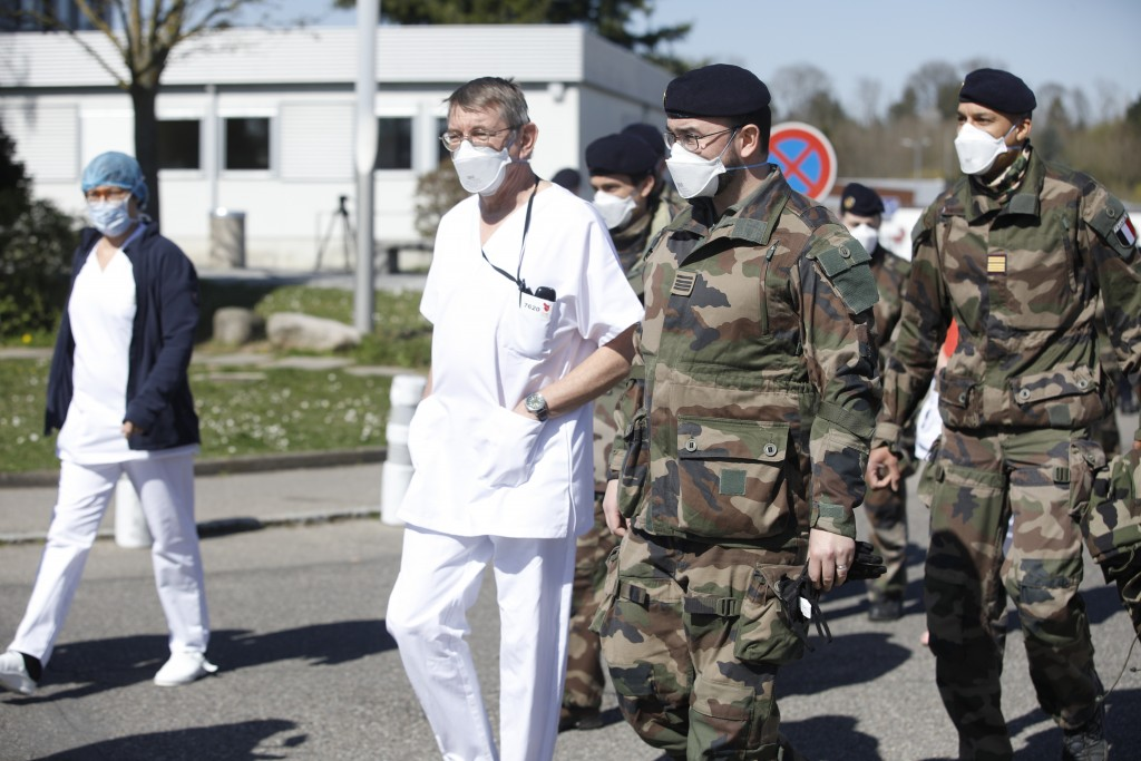 Doctors and medical staffs are invited by soldiers to visit military makeshift hospital built in Mulhouse, eastern France, Monday March 23, 2020. The ...