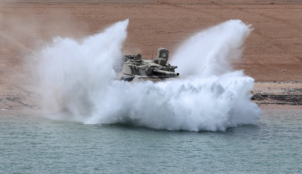 An Emirati armored personnel carrier charges into a canal during an exercise at an Emirati military base home to a Military Operations in Urban Terrai...