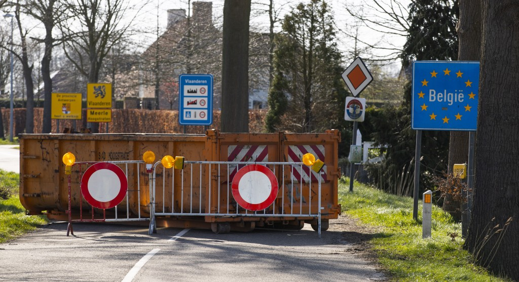 A container and barriers block a backroad used by locals on the Netherlands border with Belgium between Chaam, southern Netherlands, and Meerle, north...