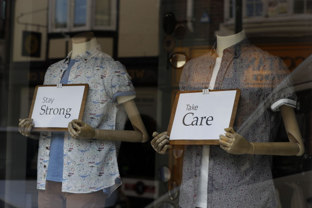 Messages of support are seen in a shop window in Windsor, England Tuesday, March 24, 2020. Britain's Prime Minister Boris Johnson on Monday imposed it...