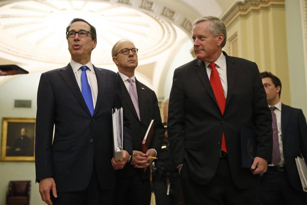 Treasury Secretary Steven Mnuchin, left, accompanied by White House Legislative Affairs Director Eric Ueland and acting White House chief of staff Mar...