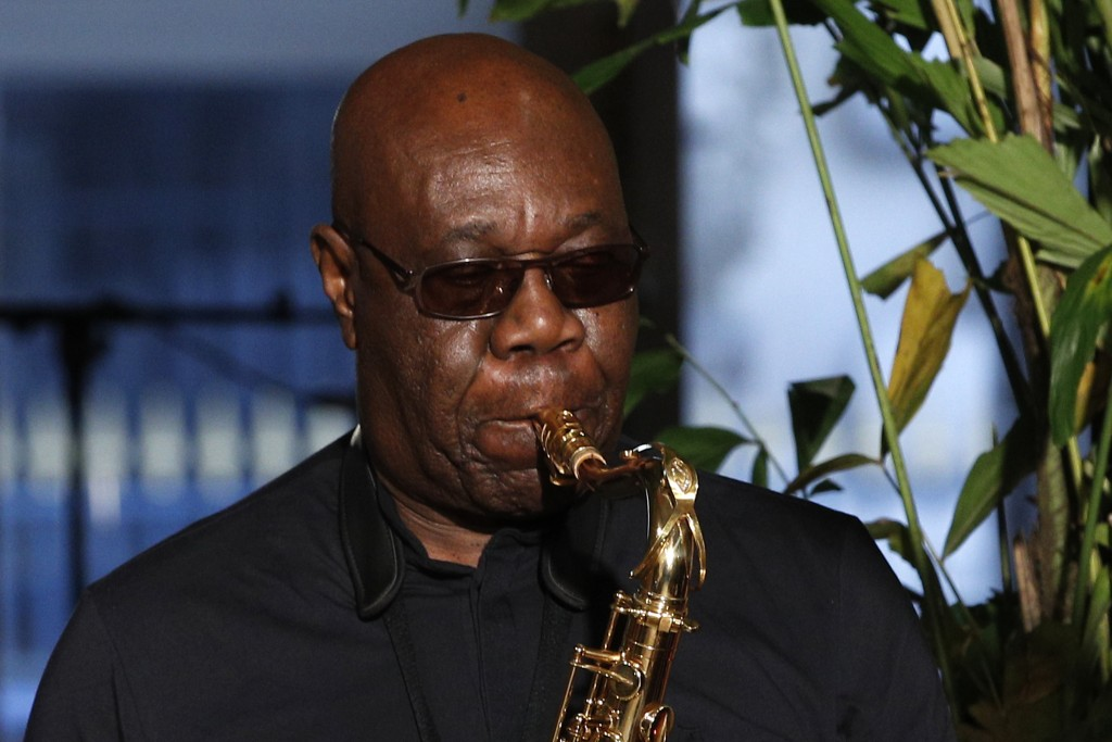 FILE - In this Jan.24, 2018 file photo, saxophonist Manu Dibango performs during Franck Sorbier's Haute Couture Spring-Summer 2018 fashion collection ...