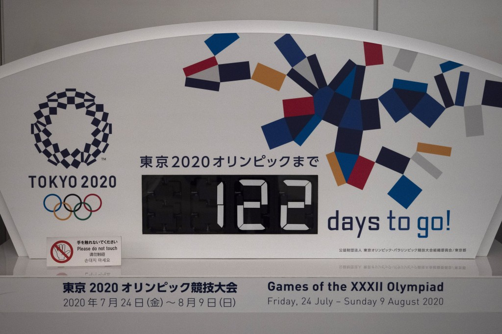 "A countdown display for the Tokyo 2020 Olympics is photographed in Tokyo, Tuesday, March 24, 2020. IOC President Thomas Bach has agreed ""100%"" to a pr..."