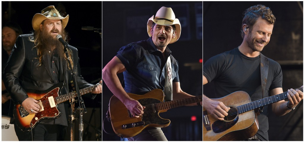 This combination photo shows country music stars, from left, Chris Stapleton, Brad Paisley and Dierks Bentley performing in concert. The multibillion-...
