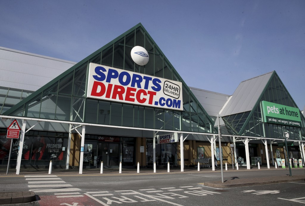A view of a closed Sports Direct store next to an open Pets at Home store, the day after Prime Minister Boris Johnson put the UK in lockdown to help c...
