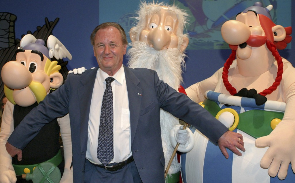 FILE - In this June 12, 2004 file photo, French illustrator Albert Uderzo poses with characters of his famous comics, Asterix, left, druid Miraculix, ...