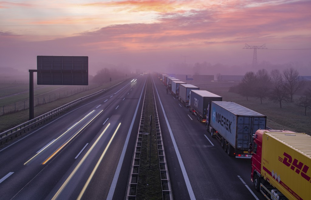 Trucks are jammed in the early morning on Autobahn 12 in front of the German-Polish border crossing near Frankfurt (Oder), Germany, March 18, 2020. (P...