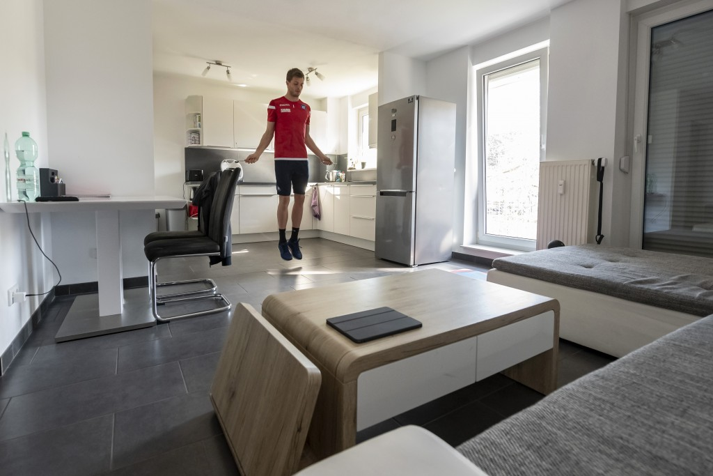 Benjamin Uphoff, a goalkeeper of the second division club Karlsruher SC, skips rope in his apartment in Karlsruhe, Germany. Due to the cancelation of ...