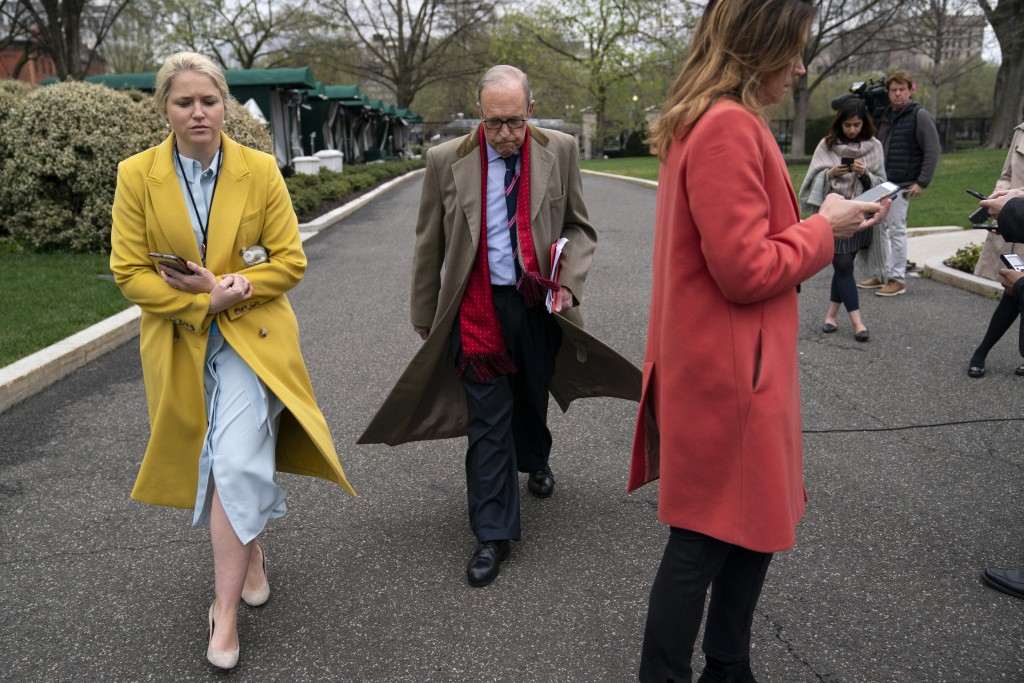 White House chief economic adviser Larry Kudlow walks off after speaking with reporters about economic impacts of the coronavirus, at the White House,...