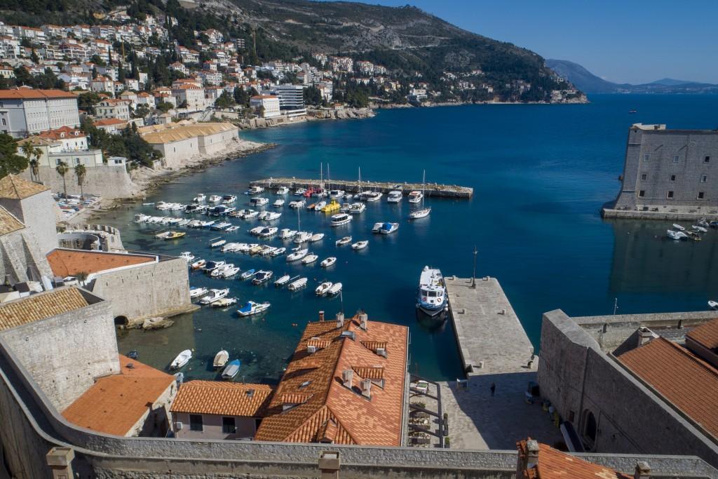 This Tuesday, March 17, 2020 aerial photo shows the old town harbor and the Lazarettos, called Lazareti in Croatian, of Dubrovnik, in Dubrovnik, Croat...