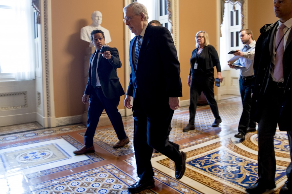 Senate Majority Leader Mitch McConnell of Ky. arrives on Capitol Hill in Washington, Monday, March 23, 2020, as the Senate is working to pass a corona...