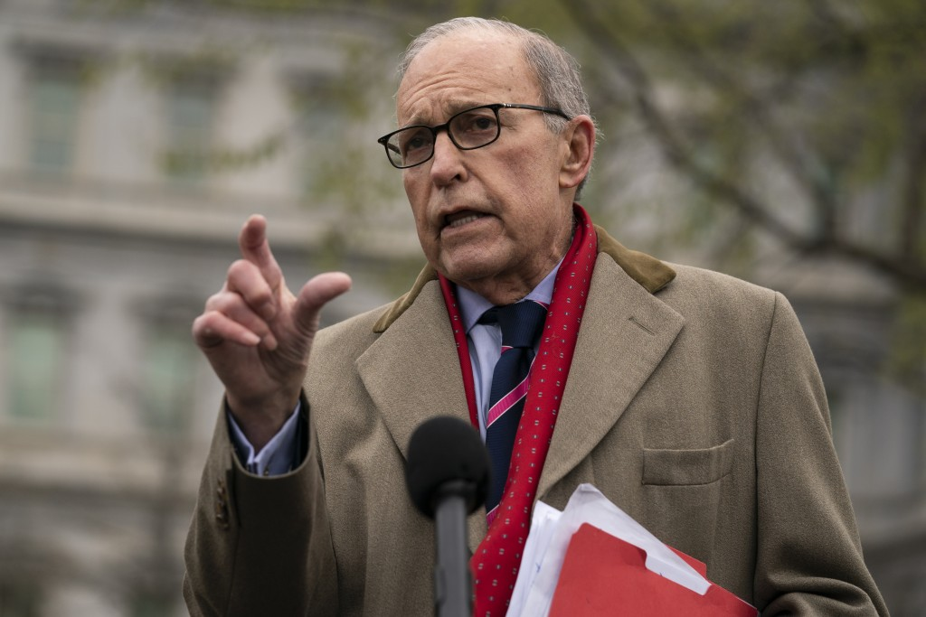 White House chief economic adviser Larry Kudlow talks with reporters about economic impacts of the coronavirus, at the White House, Tuesday, March 24,...