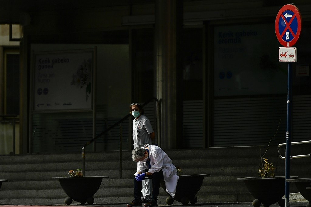 Health services staff members protest outside the Txagorritxu hospital demanding more protection equipment, after a Spanish nurse died Thursday from c...