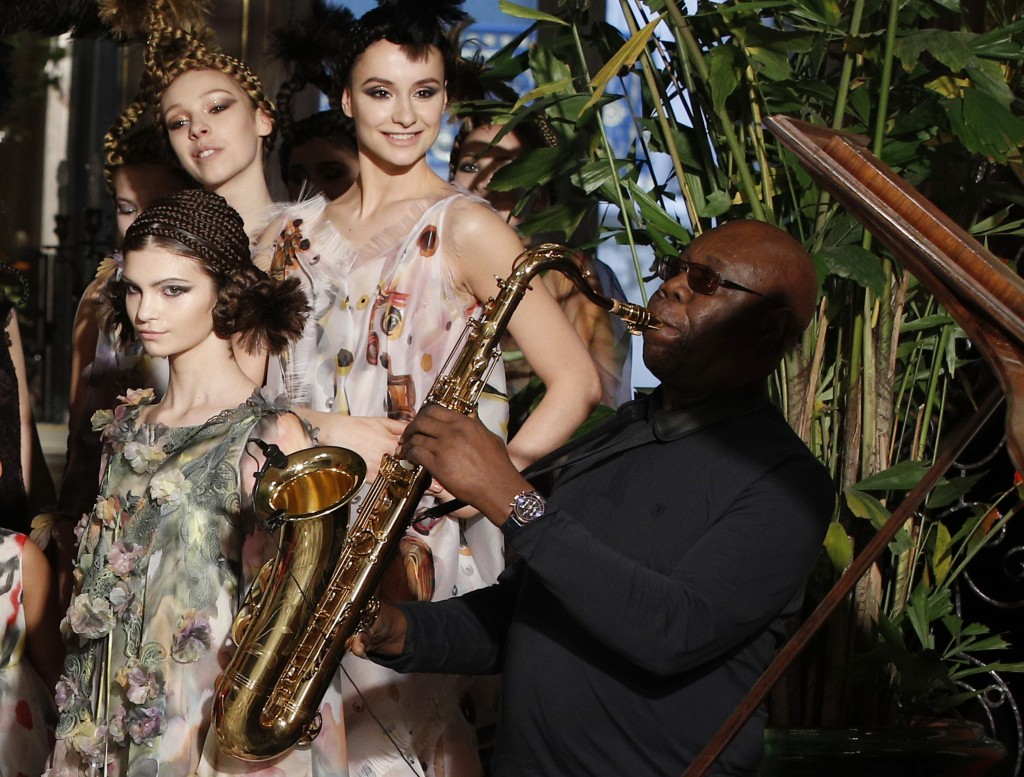 FILE - In this Jan.24, 2018 file photo, models present creations for Franck Sorbier's Haute Couture Spring-Summer 2018 fashion collection while saxoph...