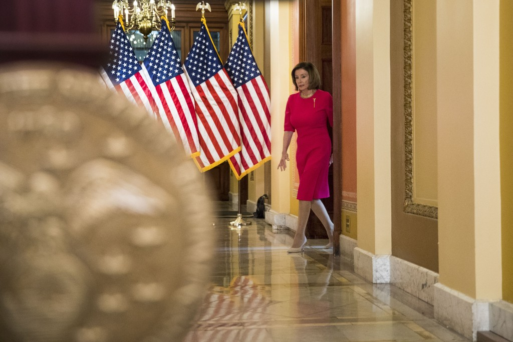 House Speaker Nancy Pelosi of Calif. arrives to read a statement outside her office on Capitol Hill, Monday, March 23, 2020, in Washington. (AP Photo/...