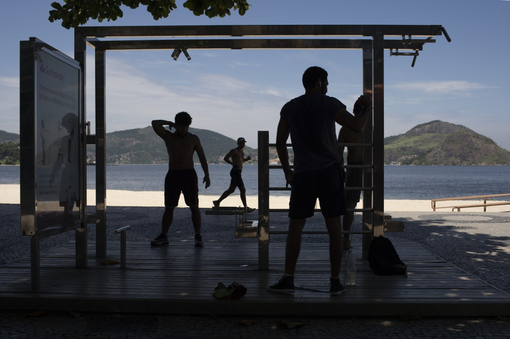 Men exercise at the Icarai beach, officially closed to visitors as a precaution against the spread of the new coronavirus, in Niteroi, Brazil, March 1...