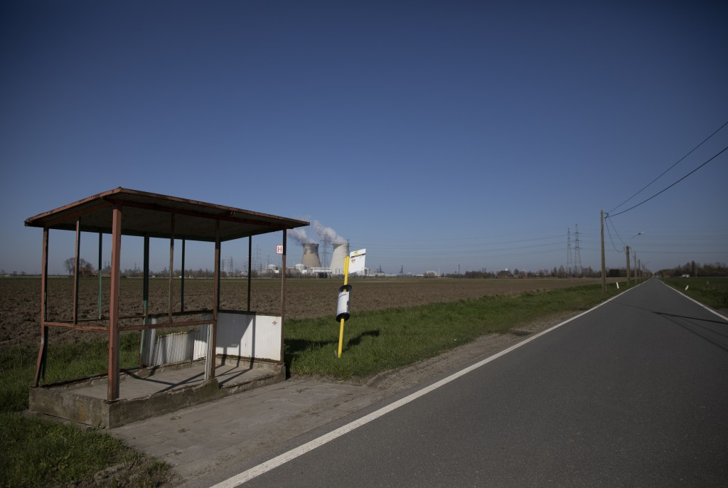 An empty bus stop on a deserted road in Doel, Belgium, Monday, March 23, 2020. Belgium's stores, schools, restaurants and bars have closed and citizen...