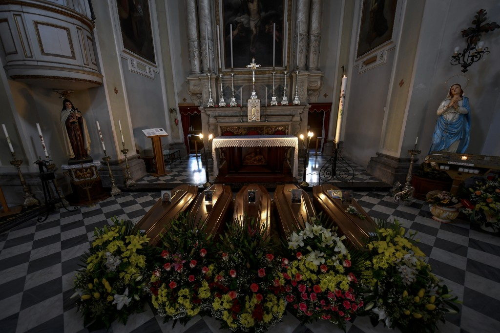 Coffins wait to be transported to cemetery, in the church of Serina, near Bergamo, Northern Italy, March 21, 2020. Italy's tally of coronavirus cases ...