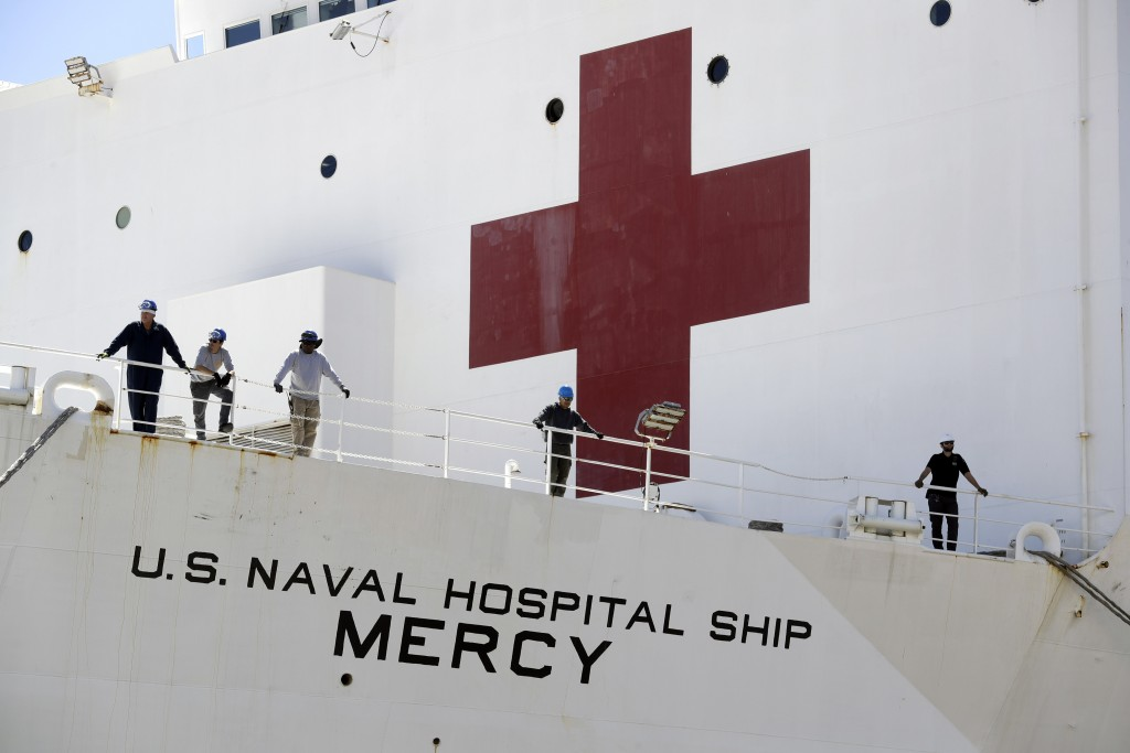 The USNS Mercy hospital ship sits at dock before its departure Monday, March 23, 2020, in San Diego. The Navy hospital ship was preparing to leave San...