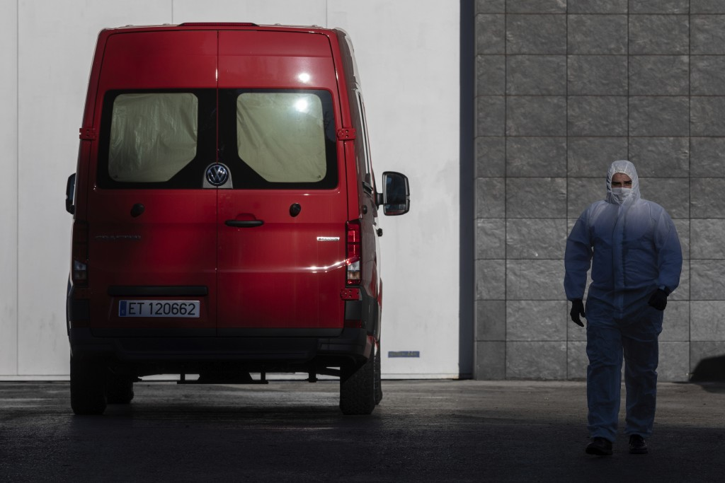 A spanish UME (Emergency Army Unit) soldier walks out of Madrid's ice rink turned into a temporary morgue due the COVID-19 crisis in Madrid, Spain, Mo...